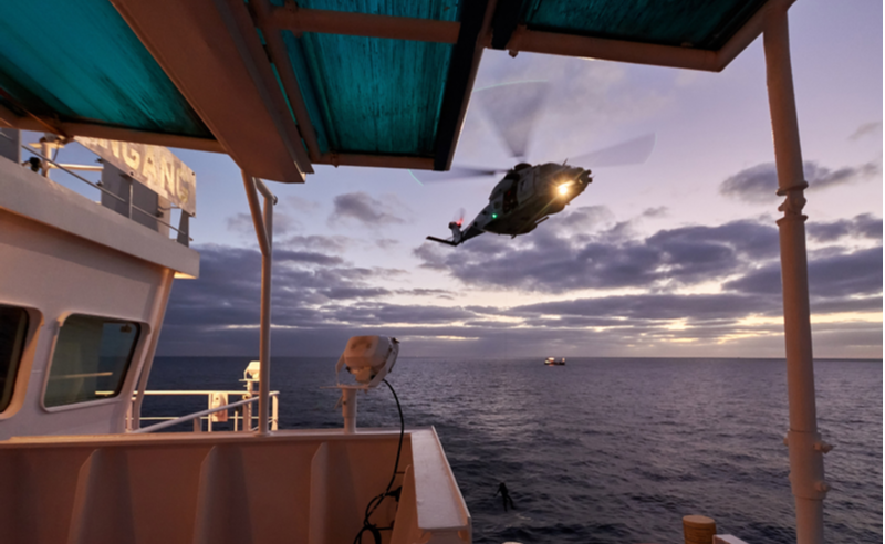 Rescue of person from ship by helicopter exercise (photo)