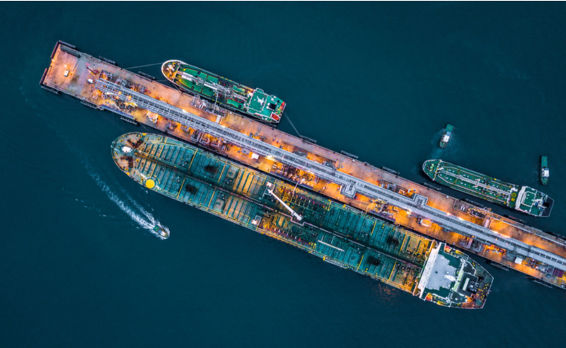 Aerial top view of oil tanker ship at the port (photo)